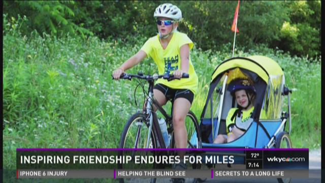Local girl competes in triathlon with disabled friend