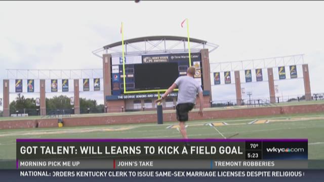 Will Ujek tackles task of kicking field goal