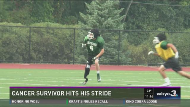 Cancer-surviving high school football player hits his stride