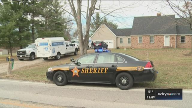 911 call: Bank robbed after family held hostage